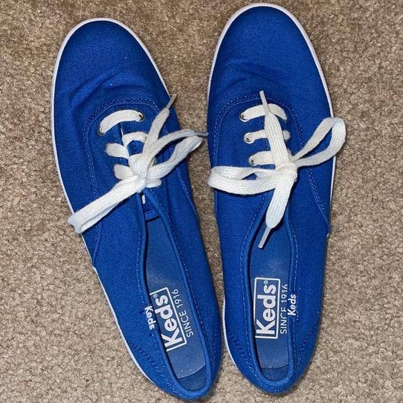Brand new, blue Keds